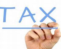 Tax written in blue by hand